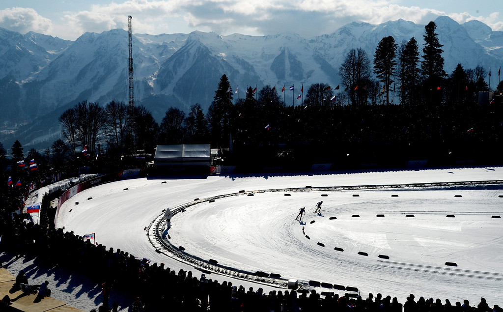 . Ivan Perrillat Boiteux of France (R) and Maxim Vylegzhanin of Russia (L) from Russia round a turn during the Men\'s 4 X 10km Relay competition at the Laura Cross Country Center during the Sochi 2014 Olympic Games, Krasnaya Polyana, Russia, 16 February 2014.  EPA/JUSTIN LANE