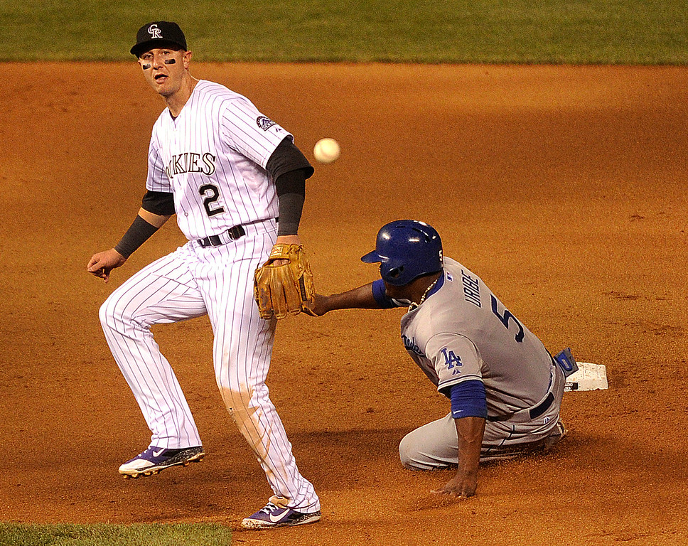 . DENVER, CO. - SEPTEMBER 4: LA baserunner Juan Uribe (5) was forced out before Troy Tulowitzki (2) completed a double play in the fifth inning. The Colorado Rockies hosted the Los Angeles Dodgers at Coors Field Wednesday night, September 4, 2013.  Photo By Karl Gehring/The Denver Post