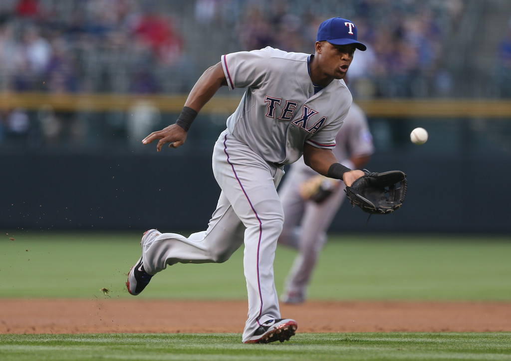 . Texas Rangers third baseman Adrian Beltre fields ground ball off the bat of Colorado Rockies\' Drew Stubbs in the first inning of an interleague baseball game in Denver on Monday, May 5, 2014. (AP Photo/David Zalubowski)