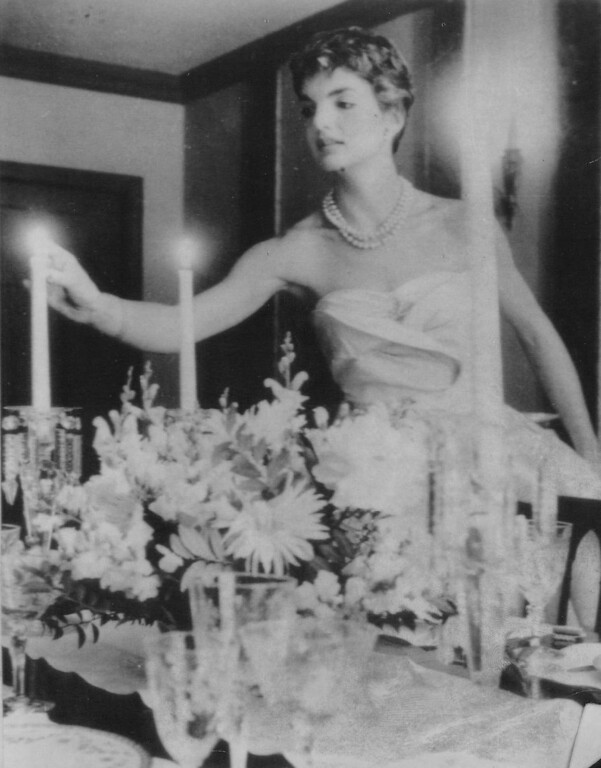. Jacqueline prepares for a candlelight meal in spring  1953.  Denver Post file