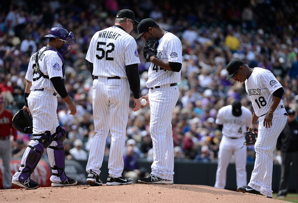 . DENVER, CO. - APRIL 21: Colorado Rockies pitching coach Jim Wright (52) pays a visit to the mound to talk with Juan Nicasio (44) during the first inning against the Arizona Diamondbacks April 21, 2013 at Coors Field. (Photo By John Leyba/The Denver Post)