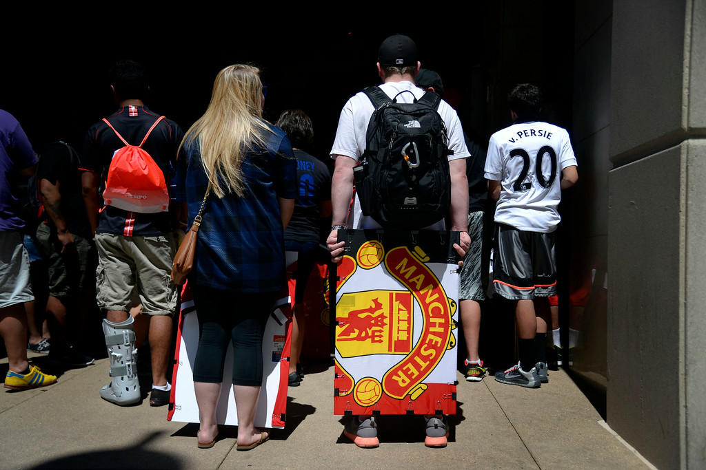 . DENVER, CO - JULY 24: Morgan (left) and Chad Eller, fans of the English soccer club Manchester United, wait for the team bus to arrive at their hotel. Manchester United will play Italian squad Roma on Saturday, July 26 and arrived in Denver on Thursday, July 24, 2014. (Photo by AAron Ontiveroz/The Denver Post)