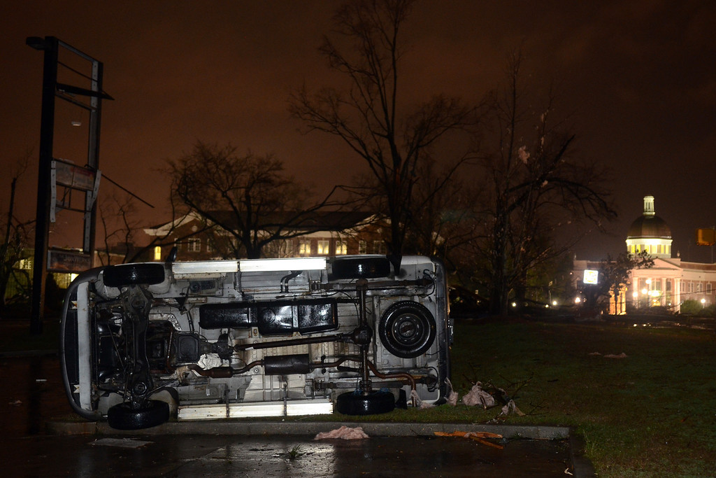 . An overturned car lies in front of the University of Southern Mississippi campus in Hattiesburg, Miss., after a possible tornado Sunday, Feb. 10, 2013. (AP Photo/Chuck Cook)