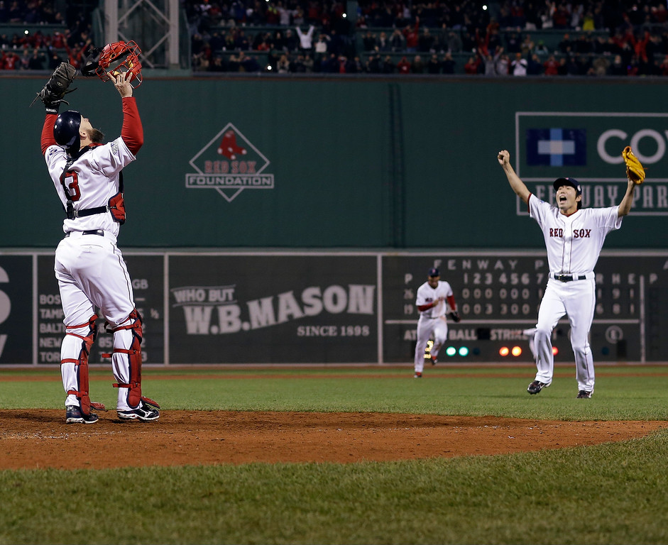 . Boston Red Sox relief pitcher Koji Uehara and catcher David Ross celebrate after getting St. Louis Cardinals\' Matt Carpenter to strike out and end Game 6 of baseball\'s World Series Wednesday, Oct. 30, 2013, in Boston. The Red Sox won 6-1 to win the series. (AP Photo/David J. Phillip)