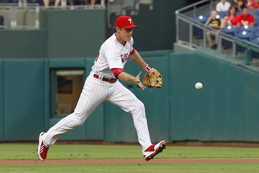 . PHILADELPHIA - AUGUST 21: Chase Utley #26 of the Philadelphia Phillies bare hands a ground ball during a game against the Colorado Rockies at Citizens Bank Park on August 21, 2013 in Philadelphia, Pennsylvania. (Photo by Hunter Martin/Getty Images)