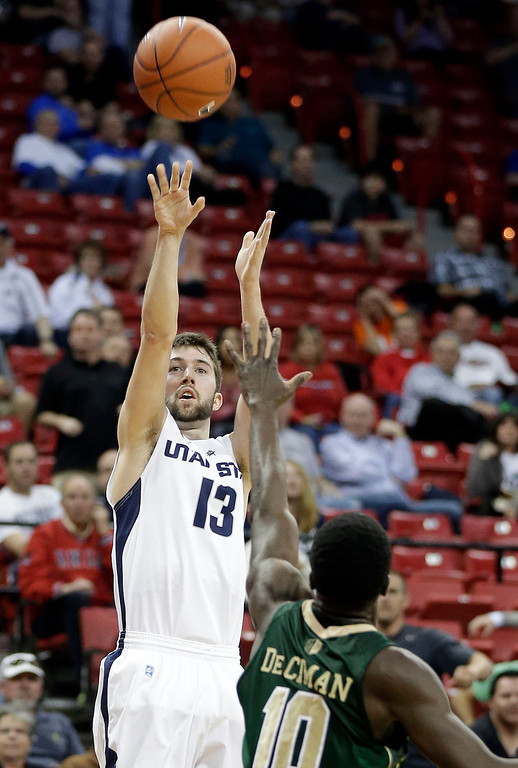 . Utah State\'s Preston Medlin shoots, covered by Colorado State\'s Joe De Ciman during the second half of a Mountain West Conference tournament NCAA college basketball game Wednesday, March 12, 2014, in Las Vegas. Utah State defeated Colorado State 73-69. (AP Photo/Isaac Brekken)