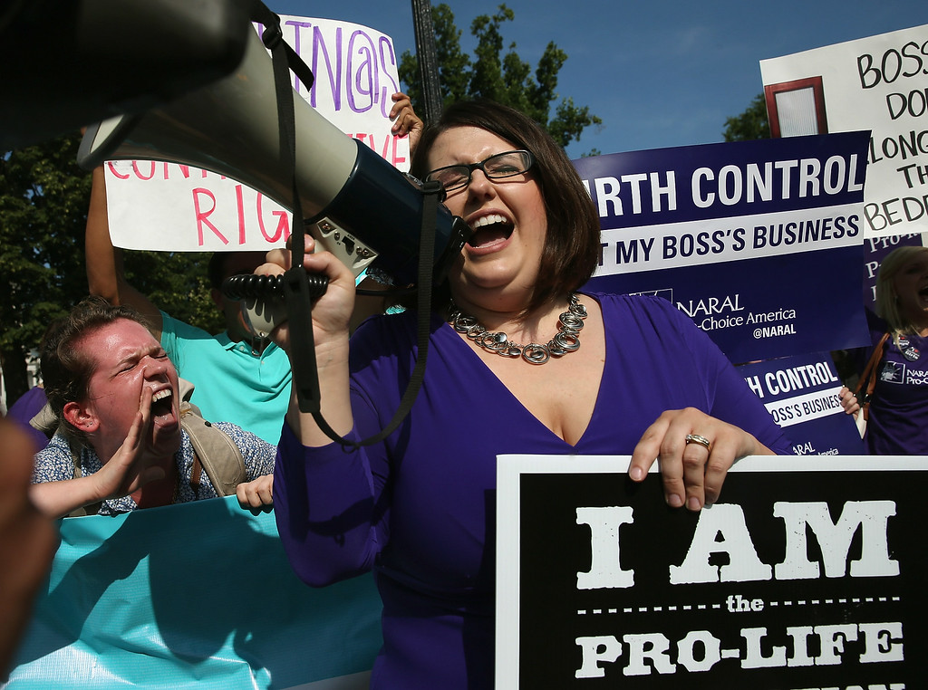 . Protesters from both sides of the birth control issue Leah Hughs (L) and Kristin Hughs (R) chant for their side in front of the U.S. Supreme Court June 30, 2014 in Washington, DC. (Photo by Mark Wilson/Getty Images)