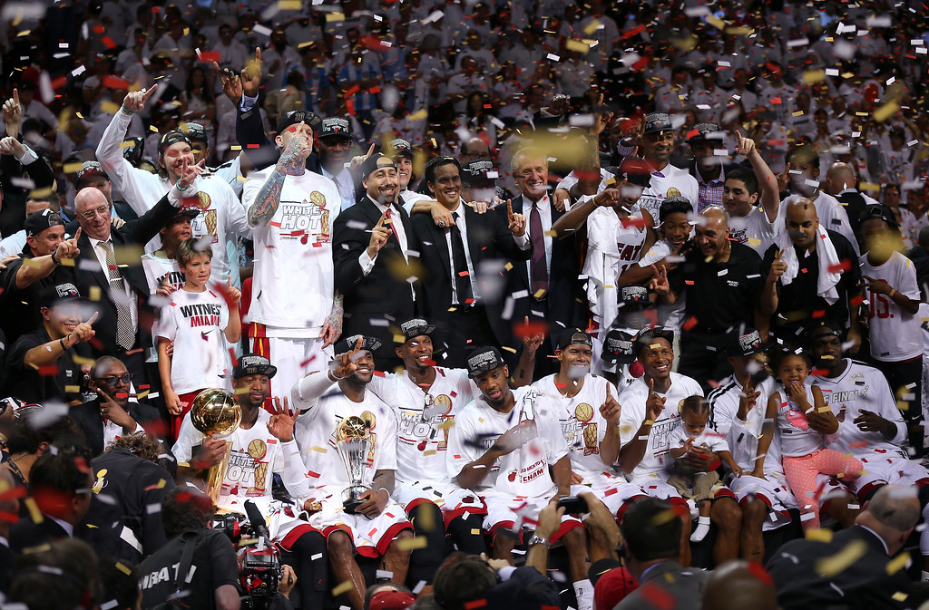 . The Miami Heat celebrate after defeating the San Antonio Spurs 95-88 to win Game Seven of the 2013 NBA Finals at AmericanAirlines Arena on June 20, 2013 in Miami, Florida.   (Photo by Mike Ehrmann/Getty Images)