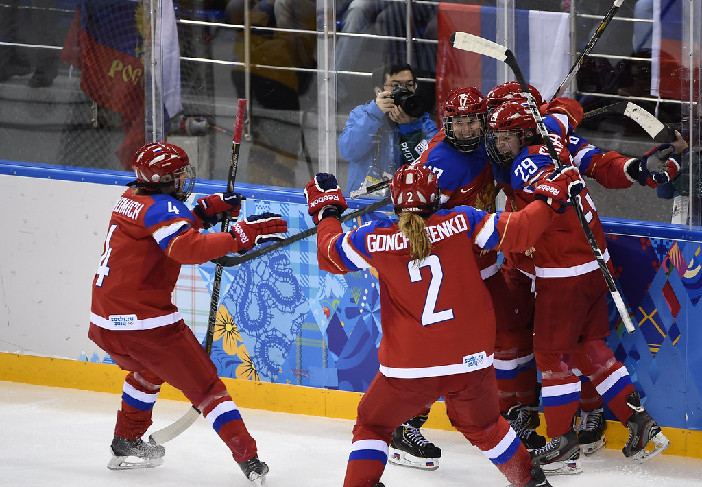 . Russia\'s Iya Gavrilova (2nd R) celebrates with team mates after scoring a goal during the Women\'s Ice Hockey Group B match between Russia and Germany at the Shayba Arena during the Sochi Winter Olympics on February 9, 2014. Russia won 4-1.  JONATHAN NACKSTRAND/AFP/Getty Images