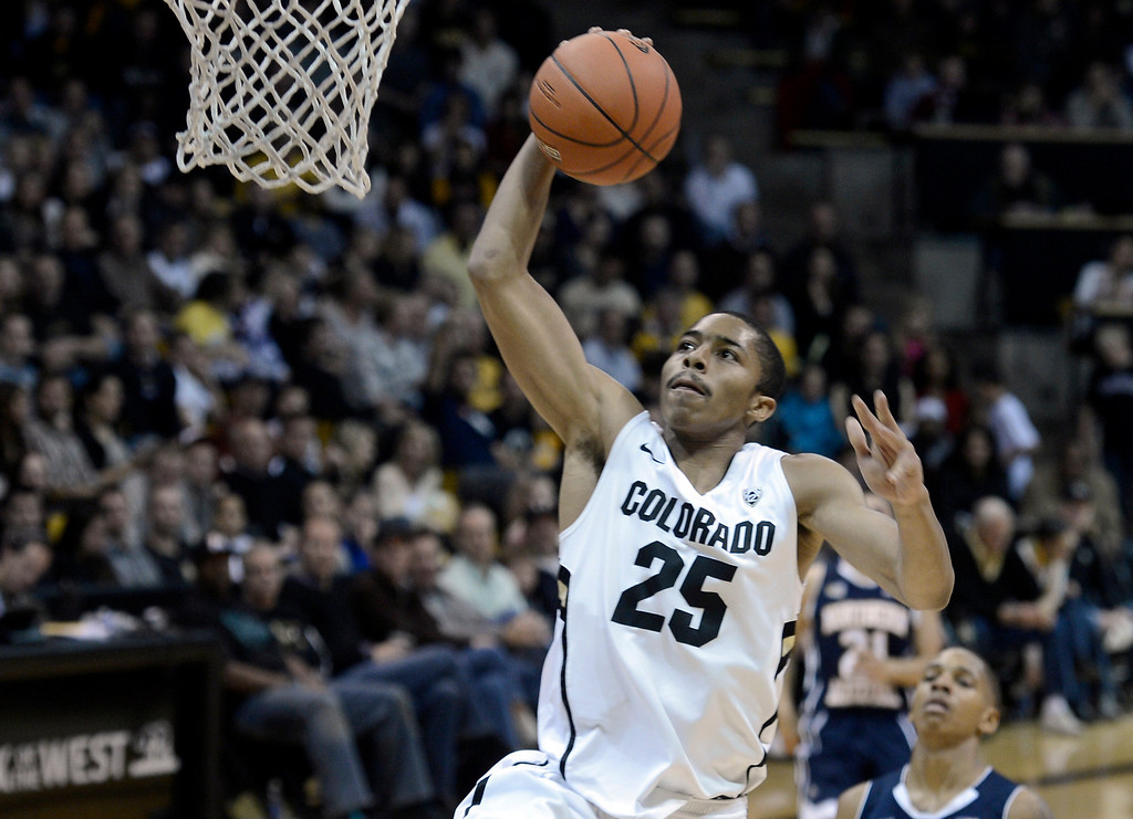 . University of Colorado\'s Spencer Dinwiddie dunks the ball after a breakaway during a game against Northern Arizona on Friday, Dec. 21, at the Coors Event Center on the CU campus in Boulder.   (Jeremy Papasso/Daily Camera)