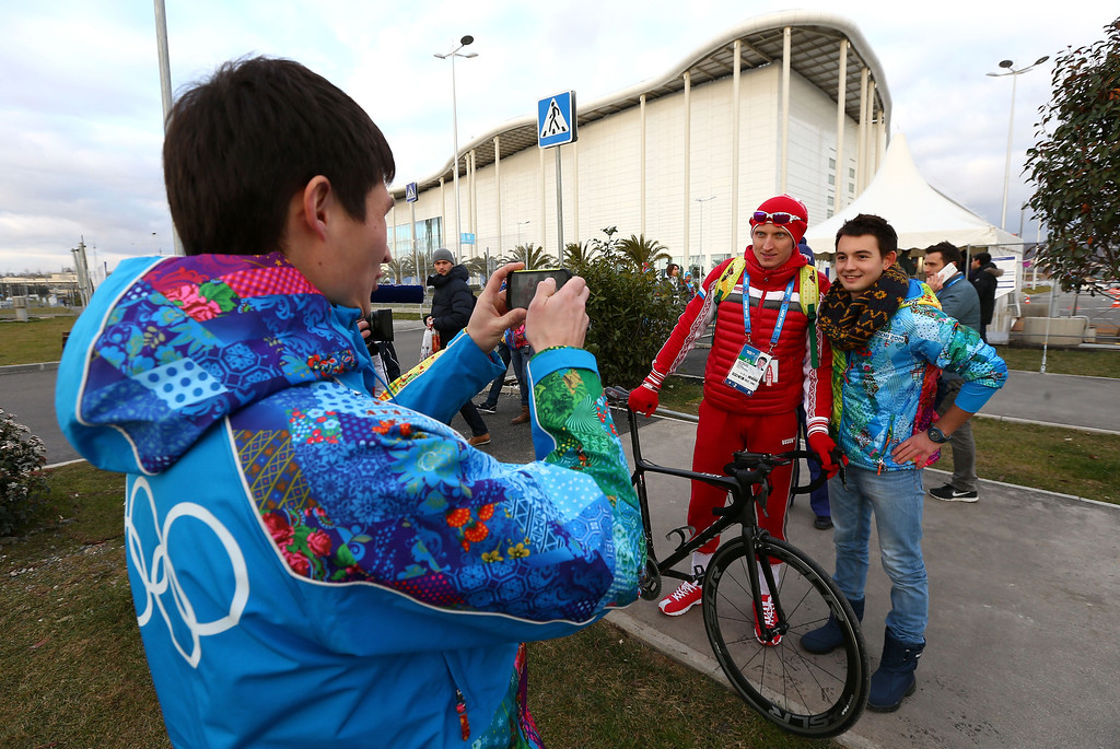 . A volunteer poses with Russian speed skater Ivan Skobrev ahead of the Sochi 2014 Winter Olympics at the Olympic Park on February 4, 2014 in Sochi, Russia.  (Photo by Streeter Lecka/Getty Images)