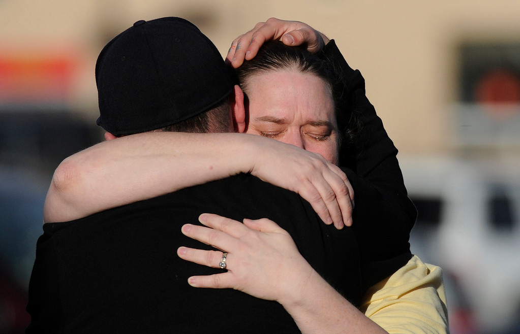 . LITTLETON, CO - DECEMBER 13 : At the school shooting at Arapahoe High School in Centennial, CO  on Friday, December 13, 2013  Ryan Archuleta hugs his tearful mom Tracy Dean a lunch room employee after she got out of the school. Photo By Cyrus McCrimmon/The Denver Post)
