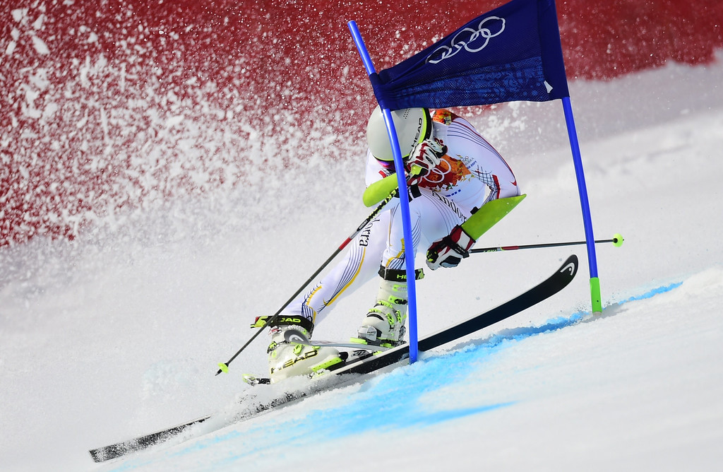 . Andorra\'s Joan Verdu Sanchez crashes during the Men\'s Alpine Skiing Giant Slalom Run 1 at the Rosa Khutor Alpine Center during the Sochi Winter Olympics on February 19, 2014.    AFP PHOTO /  FABRICE COFFRINI /AFP/Getty Images