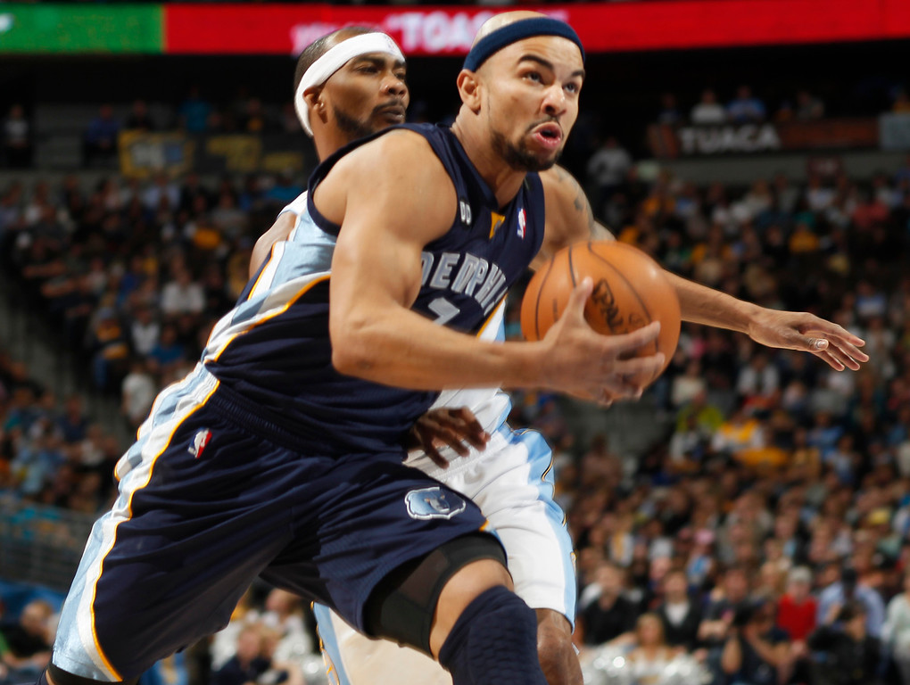 . Memphis Grizzlies guard Jerryd Bayless, front, drives the lane for a shot past Denver Nuggets forward Corey Brewer in the first quarter of an NBA basketball game in Denver, Friday, March 15, 2013. (AP Photo/David Zalubowski)