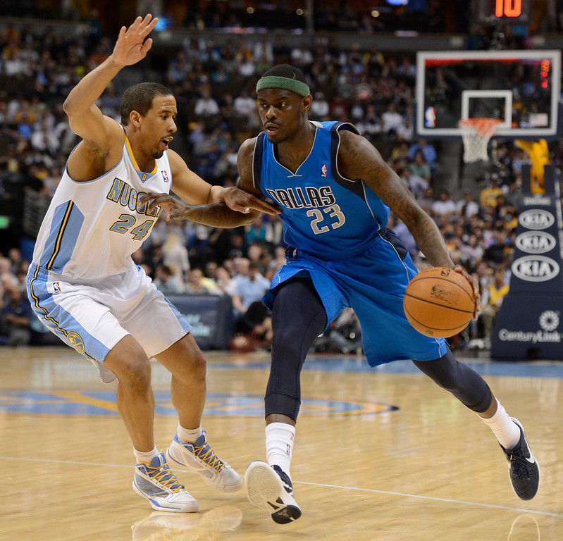 . DENVER, CO. - APRIL 04: Anthony Morrow (23) of the Dallas Mavericks drives on Andre Miller (24) of the Denver Nuggets during the third qurter  April 4,  2013 at Pepsi Center. (Photo By John Leyba/The Denver Post)