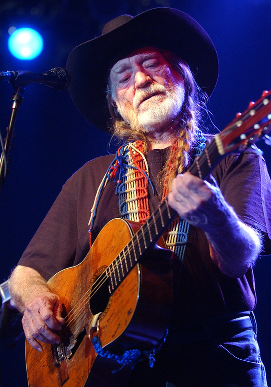 ". Willie Nelson performs during the ""Tsunami Relief  Austin to South Asia\"" concert at the Austin Music Hall in Austin, Texas, Sunday, Jan. 9, 2005. Proceeds from the $25 tickets will go to the Red Cross, UNICEF and Doctors Without Borders organizations. (AP Photo/Kelly West)"