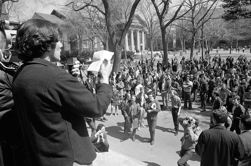 ". In this April 9, 1969 file picture, a student leader speaks from steps of the Harvard administration building at Cambridge, Mass. as part of a protest against Reserve Officers Training Corps program at the university. Forty years ago, ROTC units disappeared from Yale, Harvard, Columbia, Stanford and other elite schools, casualties of Vietnam-era tension and academic power struggles. Now, those same schools are moving toward welcoming ROTC units back thanks to the imminent demise of ""don\'t ask, don\'t tell,\"" the policy barring gays from serving openly in the U.S. military. (AP Photo/Bill Chaplis)"