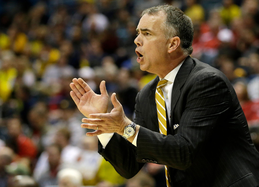. Wofford head coach Mike Young directs his team during the first half of a second round NCAA college basketball tournament game against the MichiganThursday, March 20, 2014, in Milwaukee. (AP Photo/Morry Gash)