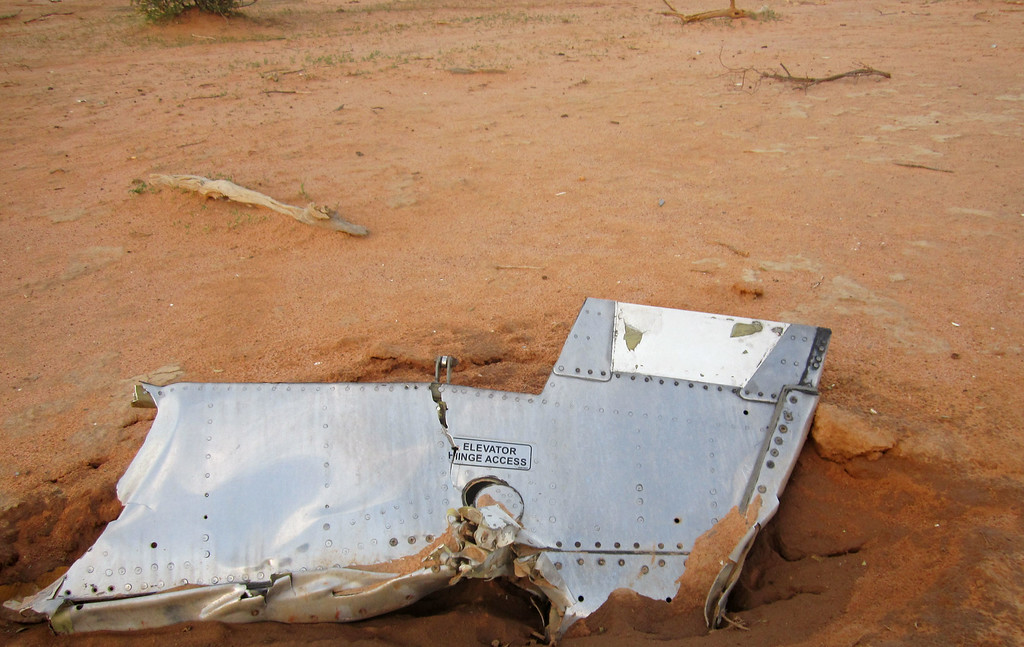 . This photo provided on Friday, July 25, 2014,  by the Burkina Faso Military shows a part of the plane at the crash site,  in Mali. French soldiers secured a black box from the Air Algerie wreckage site in a desolate region of restive northern Mali on Friday, the French president said. (AP Photo/Burkina Faso Military)