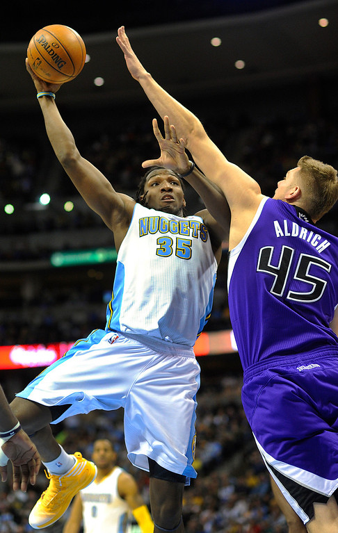. DENVER, CO. - MARCH 22: Cole Aldrich (45) of the Sacramento Kings went for a block on a shot by Kenneth Faried (35) of the Denver Nuggets in the second half. The Denver Nuggets defeated the Sacramento Kings 101-95 Saturday night, March 23, 2013 at the Pepsi Center. The Nuggets extended its longest winning streak since joining the NBA to 15 games with the win over the Kings. (Photo By Karl Gehring/The Denver Post)