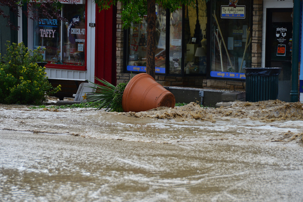 . A flower pot near the intersection of Elkhorn and Moraine in downtown Estes Park lays on its side Friday morning, Sept. 13, 2013 after being displaced by floodwater. John Cordsen/Estes Park Trail-Gazette