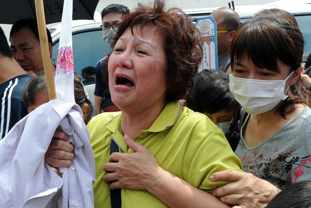 . Relatives of one of the passengers on TransAsia Airways flight GE222 pray for the victims at the crash site the day after the ATR 72-500 plane crashed near the airport at Magong on the Penghu island chain on July 24, 2014.   AFP PHOTO / Sam YehSAM YEH/AFP/Getty Images