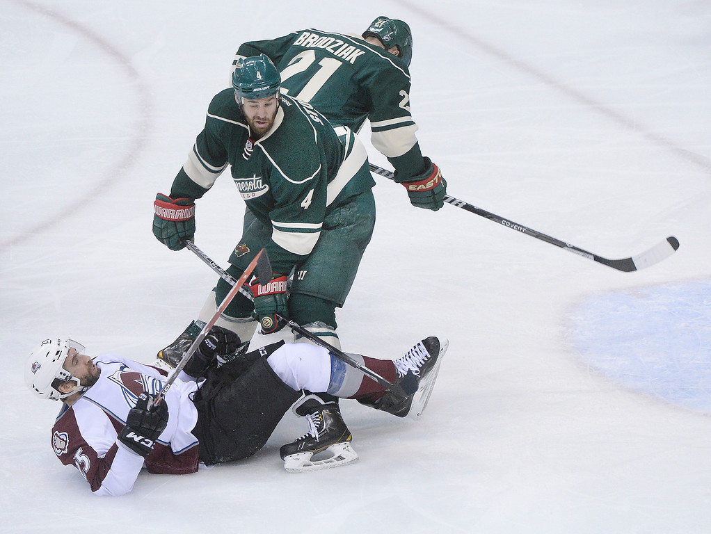 . Minnesota defenseman Clayton Stoner (4) got an interference penalty for knocking Maxime Talbot (25) to the ice in the third period. The Minnesota Wild defeated the Colorado Avalanche 5-2 Monday night, April 28, 2014 at the Xcel Energy Center in St. Paul. (Photo by Karl Gehring/The Denver Post)