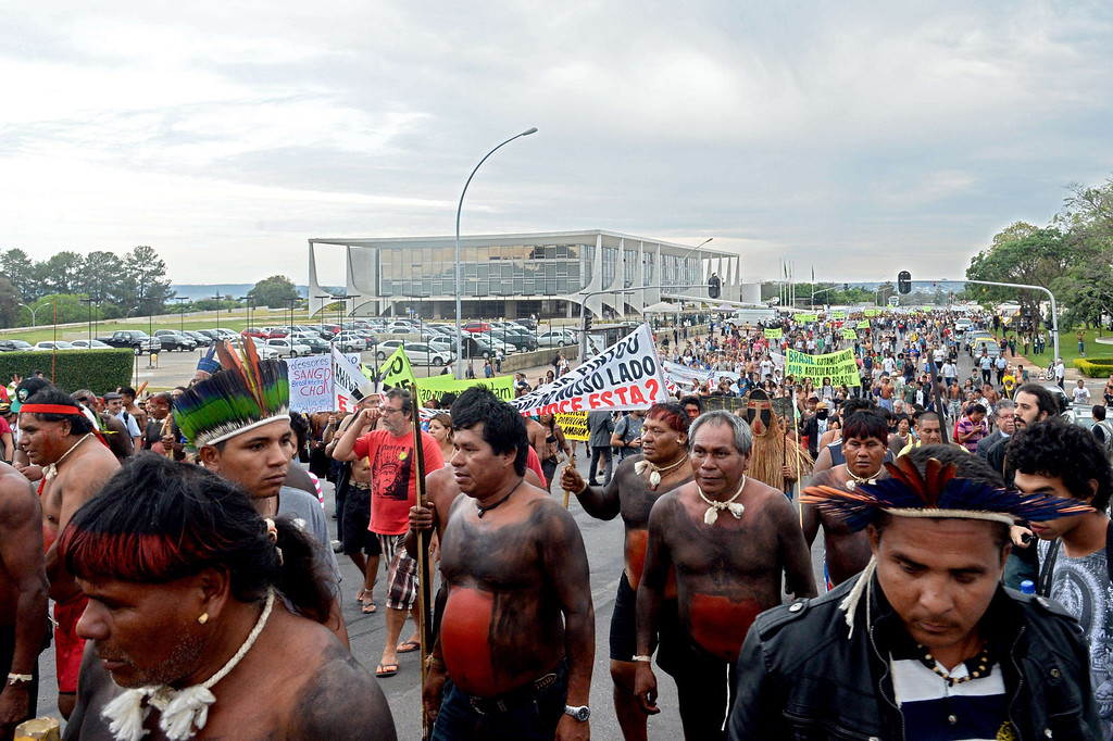 . Indigenous people march near Planalto presidential palace in Brasilia on October 1, 2013, in the beginning of the National Indigenous Mobilization Week.  AFP PHOTO / Evaristo SA/AFP/Getty Images