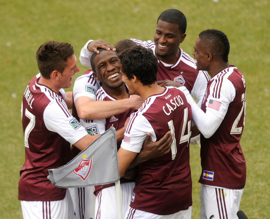 . Hendry Thomas (12) of the Colorado Rapids celebrated with teammates after converted a second half penalty kick. The Colorado Rapids tied the Portland Timbers 2-2 Saturday, March 30, 2013 at Dick\'s Sporting Goods Park in Commerce City.  Photo By Karl Gehring/The Denver Post)
