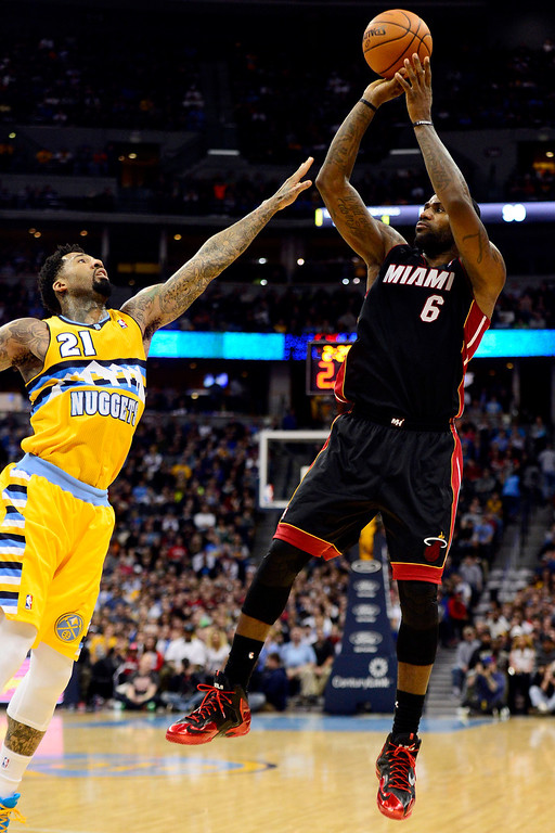 . LeBron James (6) of the Miami Heat shoots over Wilson Chandler (21) of the Denver Nuggets during the second half of Miami\'s 97-94 win.   (Photo by AAron Ontiveroz/The Denver Post)