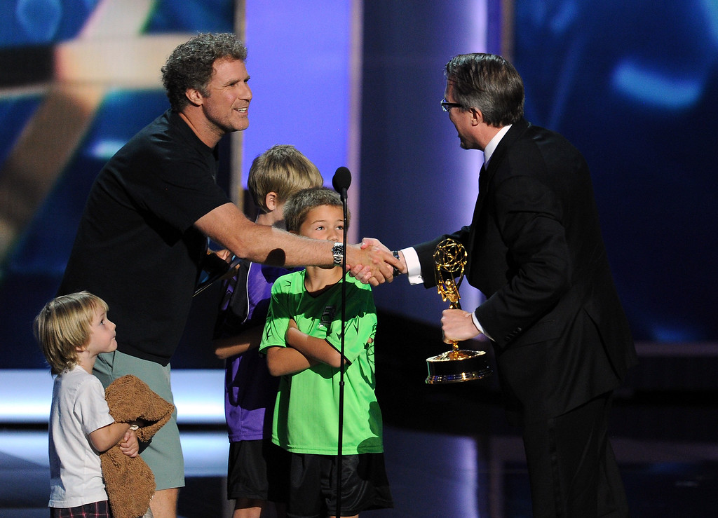 . Actor Will Farrell presents the award for Best Drama Series to Vince Gilligan onstage during the 65th Annual Primetime Emmy Awards held at Nokia Theatre L.A. Live on September 22, 2013 in Los Angeles, California.  (Photo by Kevin Winter/Getty Images)