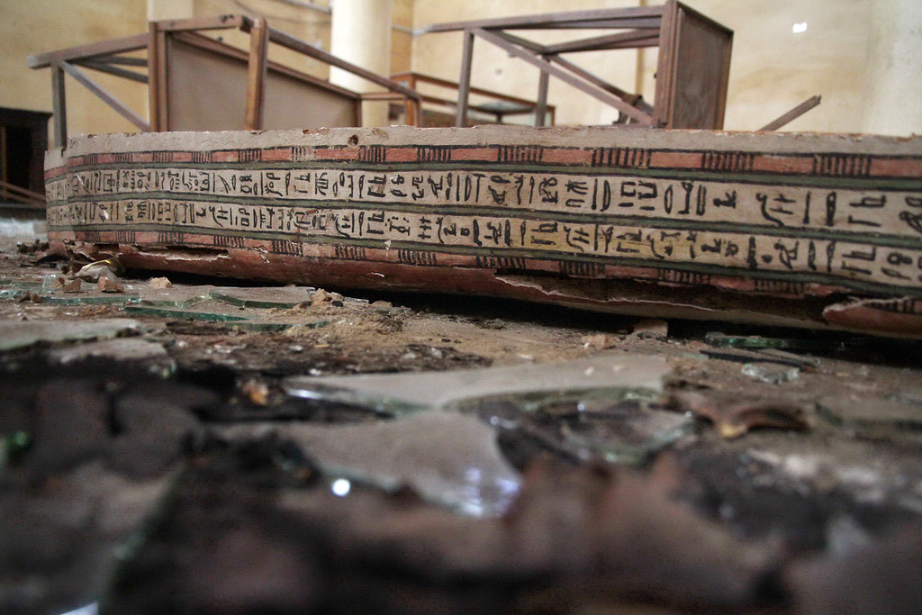 . A damaged pharaonic object lies on the floor of the Malawi Antiquities Museum after it was  ransacked and looted between the evening of Thursday, Aug. 15 and the morning of Friday, Aug. 16, 2013, in Malawi, south of Minya, Egypt, Saturday, Aug. 17, 2013. The interim Cabinet authorized police to use deadly force against anyone targeting police and state institutions on Thursday. The violence capped off a week that saw more than 700 people killed across the country. (AP Photo/Roger Anis, El Shorouk Newspaper)