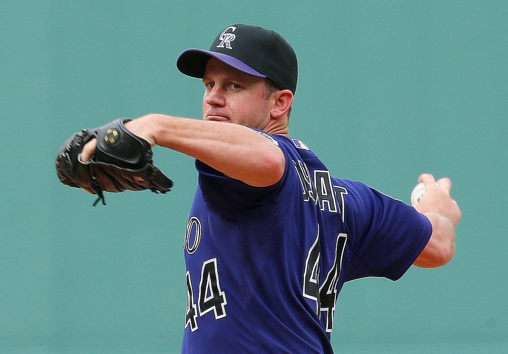 . Roy Oswalt #44 of the Colorado Rockies throws against the Boston Red Sox at Fenway Park on June 26, 2013 in Boston, Massachusetts.  (Photo by Jim Rogash/Getty Images)
