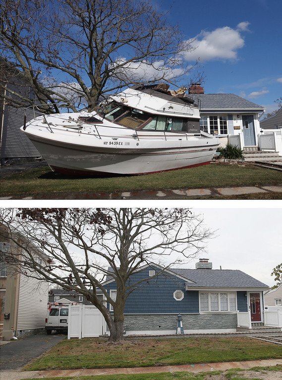 . FREEPORT, NY - NOVEMBER 02: (top) In the aftermath of Hurricane Sandy, boats continue to litter the landscape on Grant Street on November 2, 2012 in Freeport, New York. FREEPORT, NY - OCTOBER 22: (bottom) A home that had sustained damage during Superstorm Sandy sits on Grant Street on October 22, 2013 in Freeport, New York. Hurricane Sandy made landfall on October 29, 2012 near Brigantine, New Jersey and affected 24 states from Florida to Maine and cost the country an estimated $65 billion. (Photos by Bruce Bennett/Getty Images)