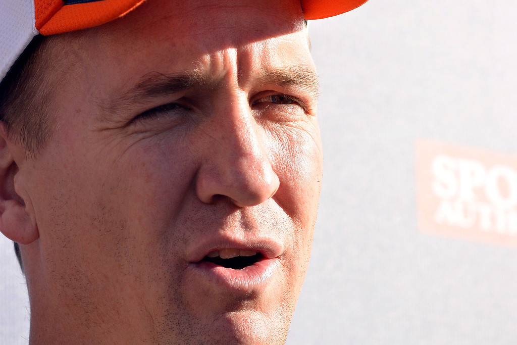 . Broncos quarterback Peyton Manning (18) meets with the media after practice November 27, 2013 at Dove Valley (Photo by John Leyba/The Denver Post)