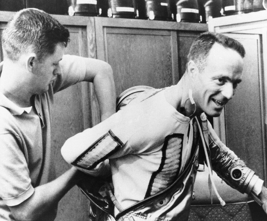 . Astronaut Scott Carpenter is assisted into his space suit by suit technician Al Rochford during preparations, May 17, 1962 at Cape Canaveral missile center for his orbital flight around the earth. Carpenter is scheduled to make a three orbit trip on Saturday. A sensor lead is taped to Carpenters neck. This photo was released at Cape Canaveral by the National Aeronautics and Space Administration. (AP Photo)