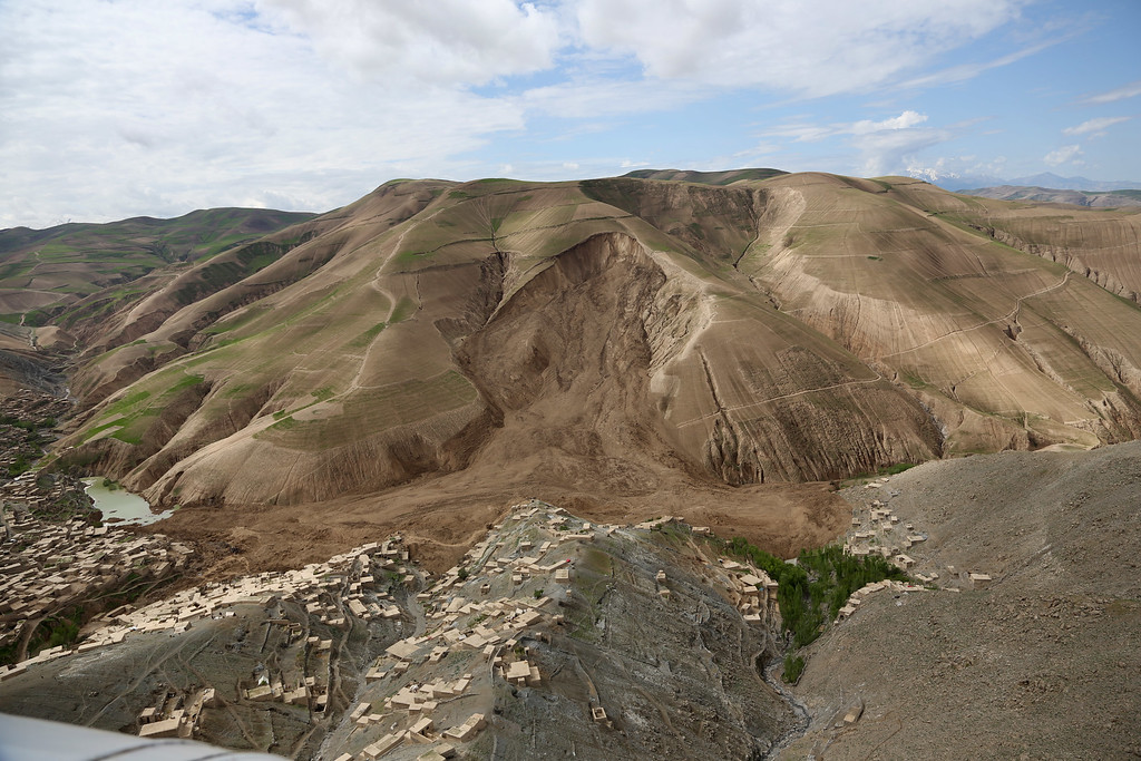 . An aerial view shows the site of Friday\'s landslide that buried Abi Barik village in Badakhshan province, northeastern Afghanistan, Monday, May 5, 2014.  (AP Photo/Rahmat Gul)