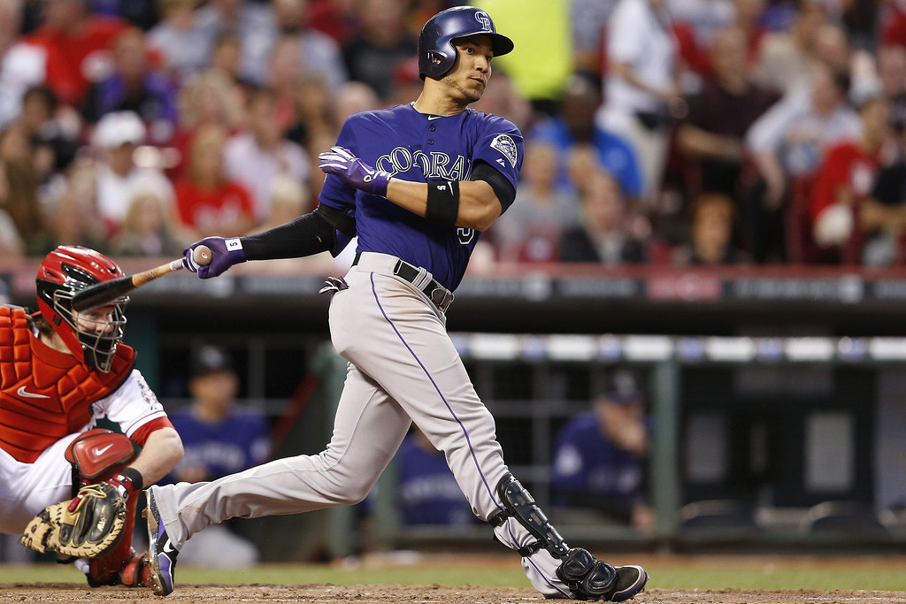 . Carlos Gonzalez #5 of the Colorado Rockies bats against the Cincinnati Reds during the game at Great American Ball Park on June 3, 2013 in Cincinnati, Ohio. The Reds won 3-0. (Photo by Joe Robbins/Getty Images)