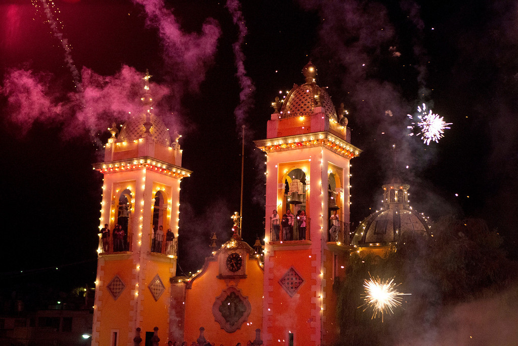 . People watch from the towers of the Santa Rosa Xochiac church, as fireworks explode during the Burning of Judas, in Mexico City. The Burning of Judas is an Easter-time ritual in Santa Rosa Xochiac, where neighborhood groups build representations of Judas which are then destroyed in blazes of fireworks and small explosives. (AP Photo/Rebecca Blackwell)