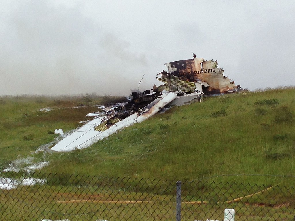 . This August 14, 2013 photo provided by the National Transportation Safety Board(NTSB) shows the remains of a UPS cargo plane that crashed Wednesday in a grassy area outside an airport in Birmingham, Alabama and broke into pieces, killing the two-member crew. The Airbus A300 belonging to the freight handling company UPS was traveling from Louisville in Kentucky and crashed while approaching Birmingham airport, about half a mile north of the runway, said Kathleen Bergen, an official with the Federal Aviation Administration.  AFP PHOTO / HO / NTSB HO/AFP/Getty Images