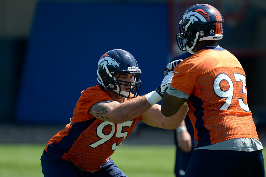 . Derek Wolfe (95) and Jeremy Beal (93) of the Denver Broncos work on drills during mini camp June 11, 2013 at Dove Valley. (Photo By John Leyba/The Denver Post)