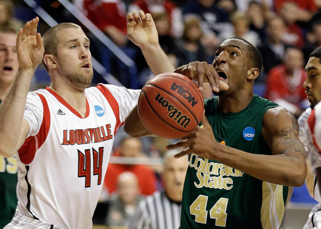 . Colorado State forward Greg Smith, front right, loses control of the ball as he drives past Louisville forward Stephan Van Treese, front left, during a third-round NCAA college basketball tournament game on Saturday, March 23, 2013, in Lexington, Ky. (AP Photo/John Bazemore)