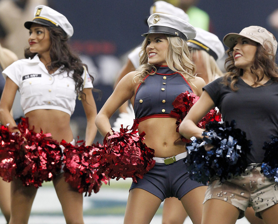 . Houston Texans cheerleaders perform while the Houston Texans play against the Oakland Raiders on November 17, 2013 at Reliant Stadium in Houston, Texas. Raiders won 28 to 23.(Photo by Thomas B. Shea/Getty Images)