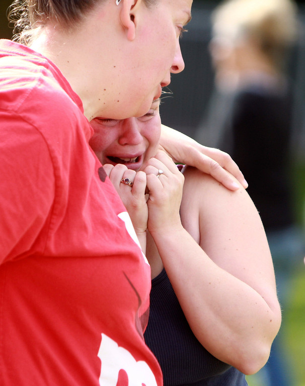 . Two women comfort each other as they await word about the safety of students after a shooting at Reynolds High School Tuesday, June 10, 2014, in Troutdale, Ore.  (AP Photo/The Oregonian, Faith Cathcart)