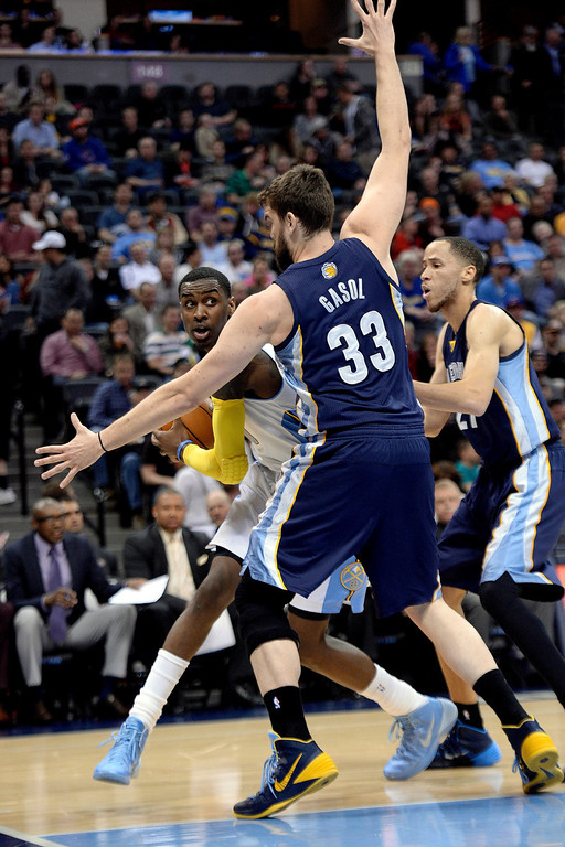 . Memphis Grizzlies center Marc Gasol (33) and forward Tayshaun Prince (21) guard Denver Nuggets forward Quincy Miller (30) during the first quarter. (Photo by AAron Ontiveroz/The Denver Post)