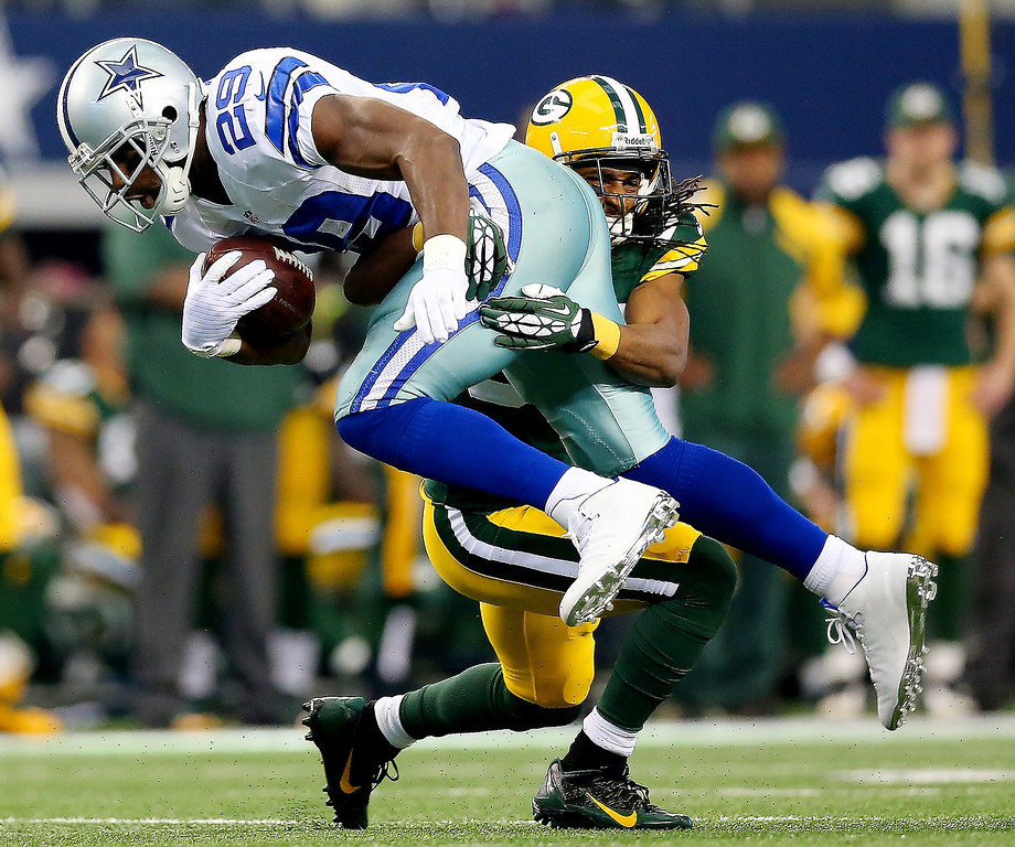 . Running back DeMarco Murray #29 of the Dallas Cowboys is tackled by cornerback Tramon Williams #38 of the Green Bay Packers during a game at AT&T Stadium on December 15, 2013 in Arlington, Texas.  (Photo by Ronald Martinez/Getty Images)