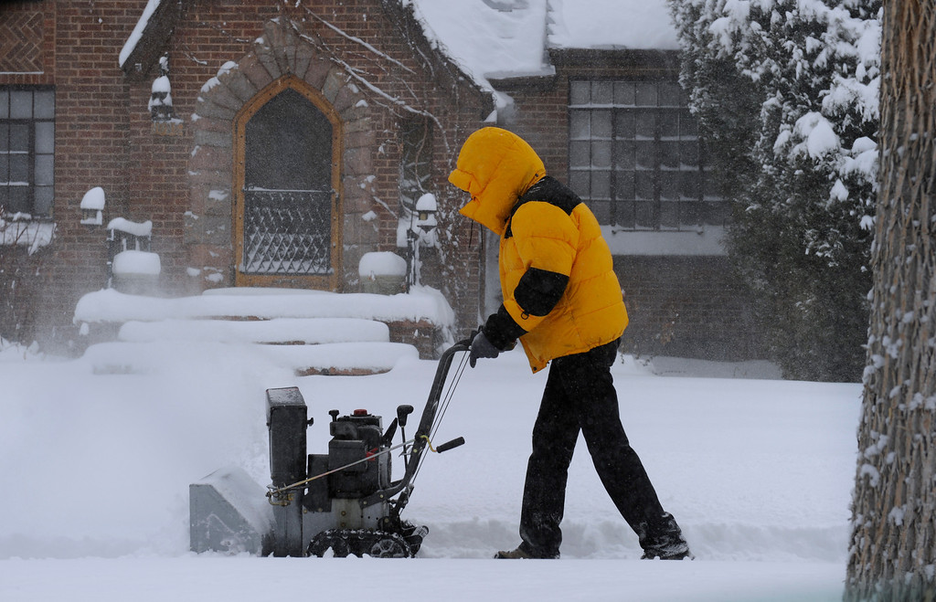 . DENVER, CO.- MARCH 23: People use their snow blowers to clear the sidewalks in the Park Hill neighborhood. Snow arrived overnight in Denver and for much of Colorado with a foot or more expected in some areas of the foothills and eastern planes. (Photo By Kathryn Scott Osler/The Denver Post)