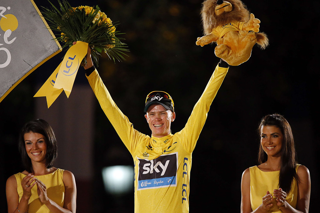 . Tour de France 2013 winner Britain\'s Christopher Froome poses on the podium in Paris on the Champs-Elysee avenue, at the end of the 133.5 km twenty-first and last stage of the 100th edition of the Tour de France cycling race on July 21, 2013 between Versailles and Paris.  JEFF PACHOUD/AFP/Getty Images