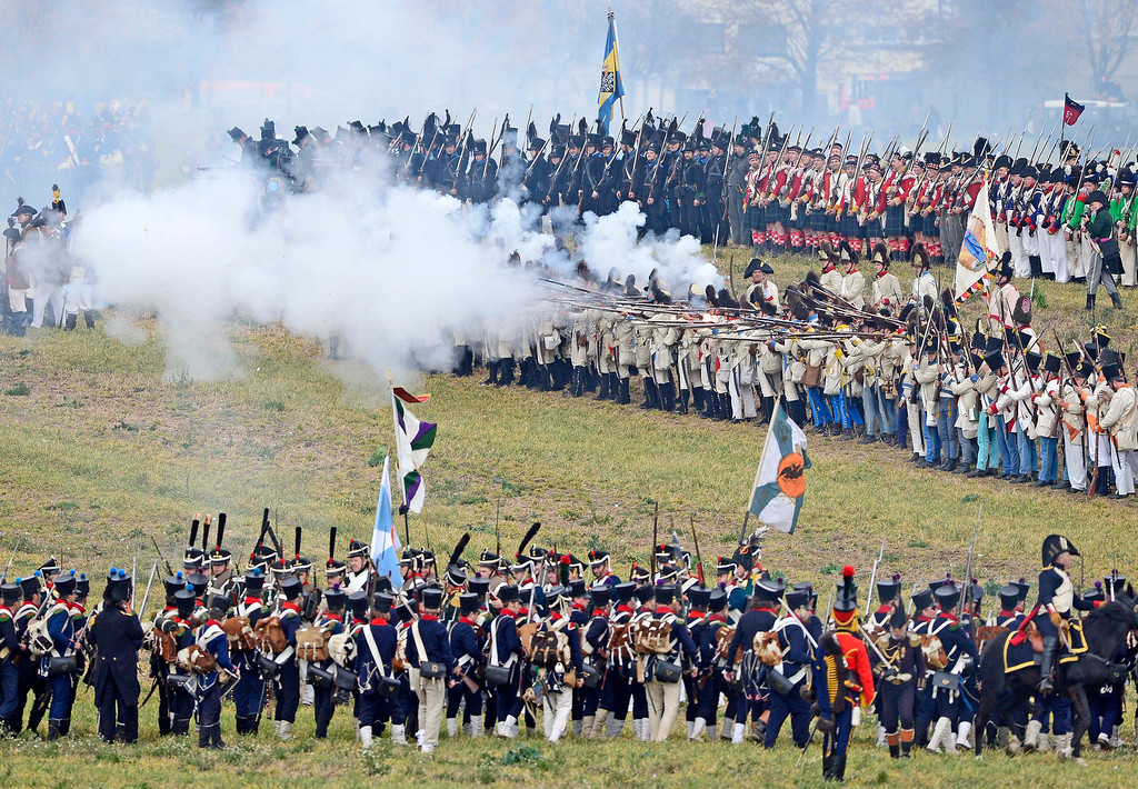 . Troops are shooting during the reconstruction of the Battle of the Nations at the 200th anniversary near Leipzig, central Germany, Sunday, Oct. 20, 2013.  (AP Photo/Jens Meyer)