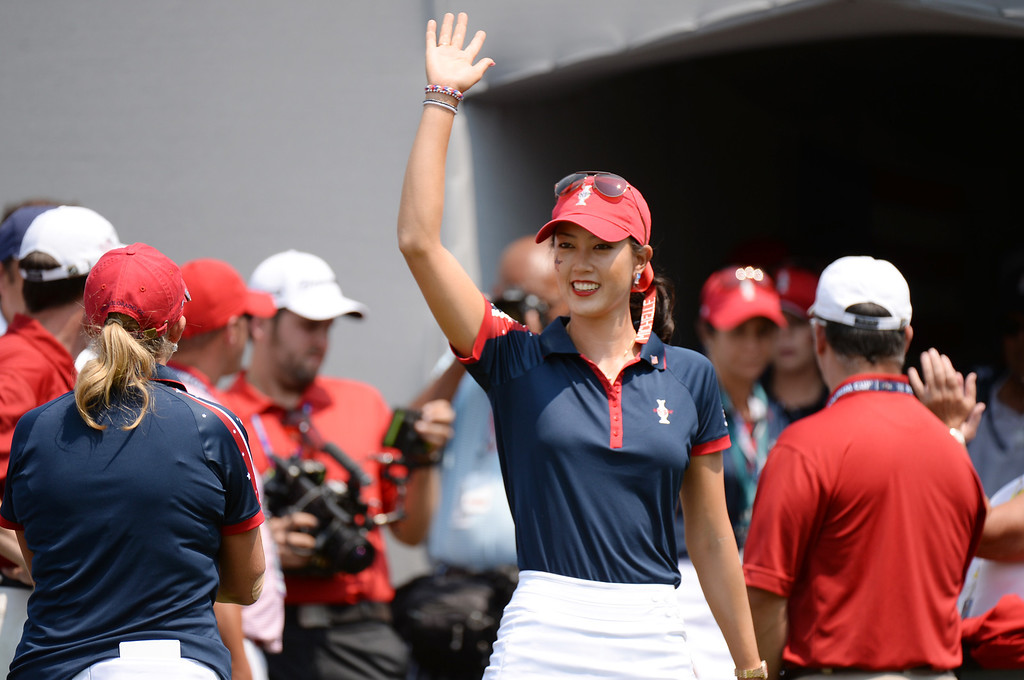 . PARKER, CO. - August 16: Michelle Wie of team USA is waiving to her fans from 1st tee ground during  2013 Solheim Cup at Colorado Golf Club. Parker, Colorado. August 16, 2013. (Photo By Hyoung Chang/The Denver Post)